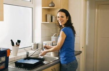 Woman washing paintbrushes
