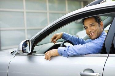 Businessman sitting in car