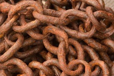 Close-up of a heap of rusty chains