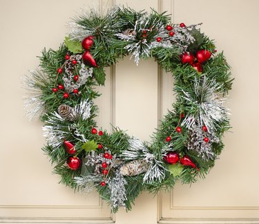 """Christmas wreath with cones, baubles, and berries"""
