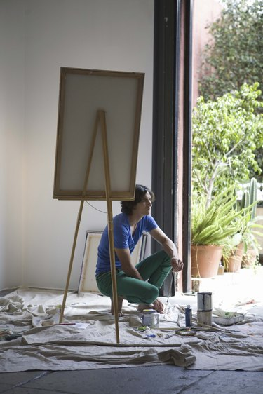 Artist painting with easel