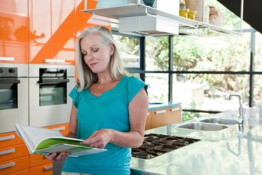 Woman looking at cook book