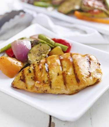 summertime barbecue chicken with vegetables.