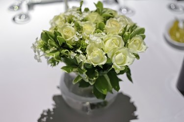 White roses in a glass vase.
