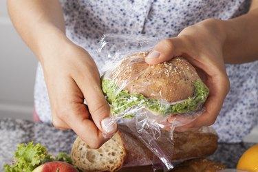 Mother foiling a sandwich