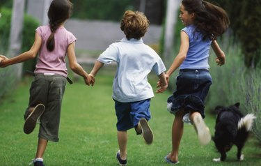Boy (10-11) running with two girls (11-12)