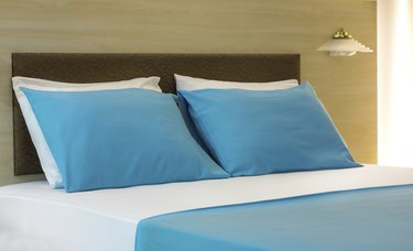 Comfortable Turqoise Pillows and Bed