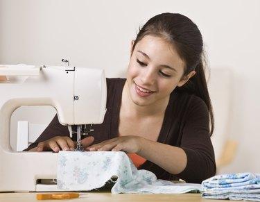 Beautiful Young Girl Sewing