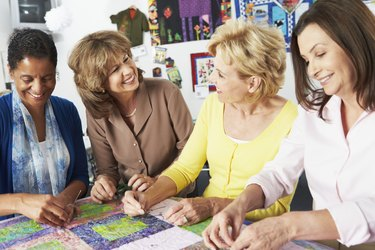 Group Of Women Making Quilt Together