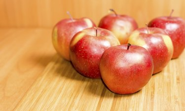 Fresh red apples on a wooden background