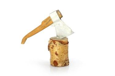 axe toy in stump