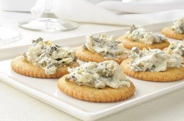 Crackers with spinach artichoke spread