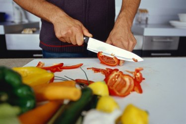 view of a person slicing tomatoes