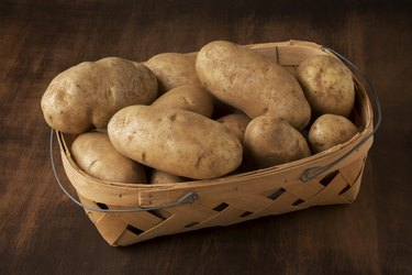 Basket of Russet Potatoes on a Table
