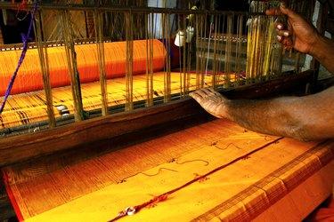 A man weaving a cloth