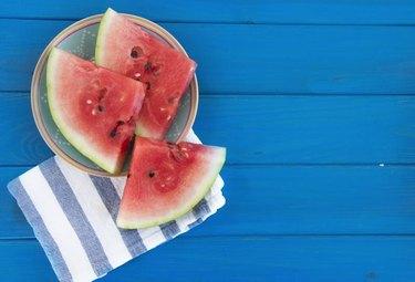 watermelon on a blue desk