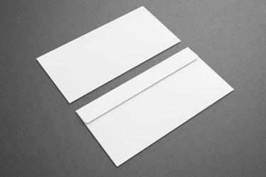 Blank envelopes on dark background. Front and back side.