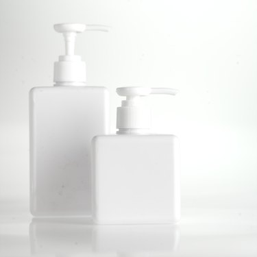 White liquid soap dispensers, close up