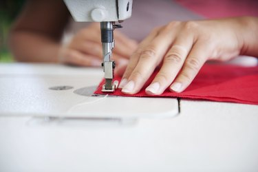 Using sewing machine.