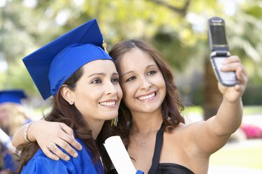 Graduate With a Friend, Taking a Picture of Themselves With a Mobile Phone