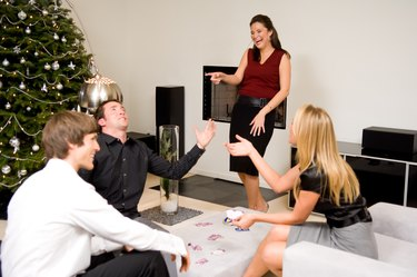 Friends playing game in living room