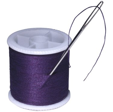 Needle and spool of thread