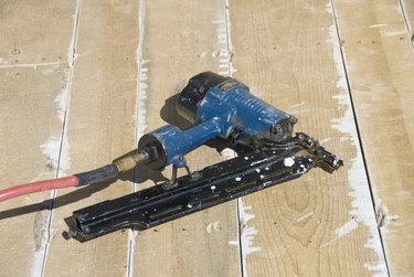 Nail Gun – Framing Nailer  - Lying on Roof Boards