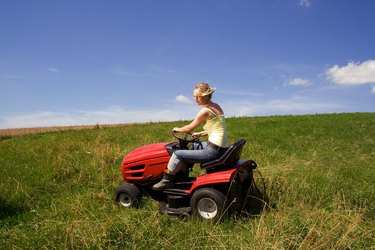 young girl with mowing machine