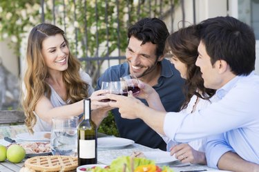 Group Of Friends Toasting Wine Glass