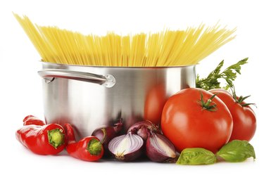 Stainless pot with spaghetti isolated on white