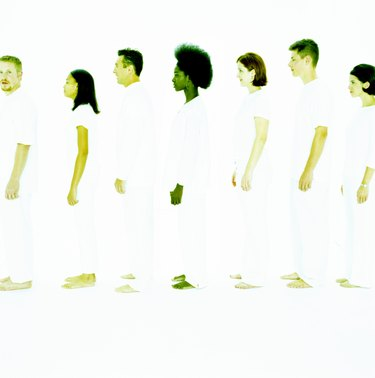 Group of teenagers and adults in white, profile
