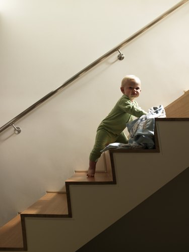 Baby boy with blanket on staircase