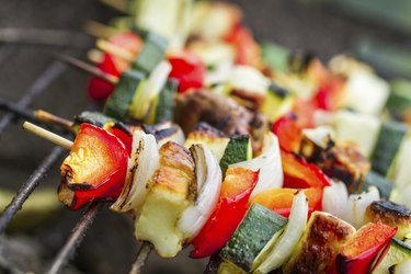 Skewers with chiken and vegetables on the grill