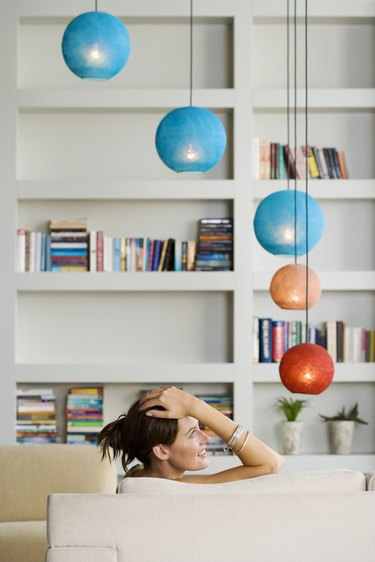 Woman relaxing in modern living space