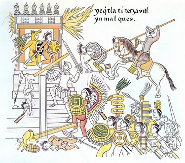 Spanish conquistadors attack an Aztec temple