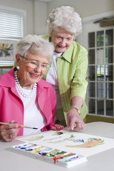 Elderly women painting