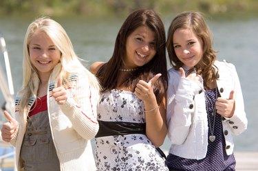 Teenage girl friends posing together
