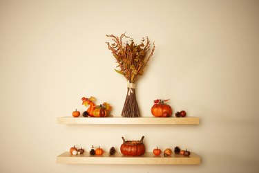 Thanksgiving decorations on shelves on wall
