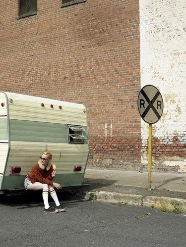 woman eating ice cream on trailer bumper