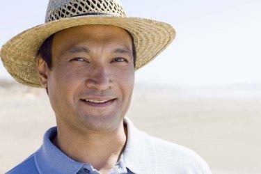 Portrait of man in straw hat