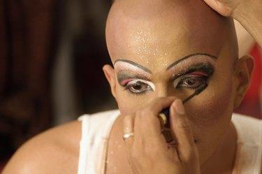 Drag queen applying mascara