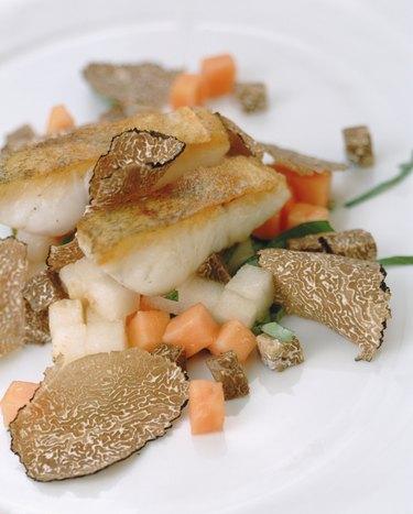 Truffle, seafood, mushroom and vegetable on plate, close-up