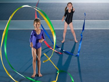 Girls doing rhythmic gymnastics