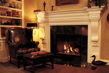 Leather chair in front of fireplace