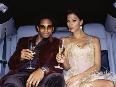 Stars celebrating in limousine