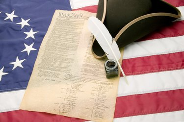 Tri-cornered hat, United States Constitution and 13-star American flag