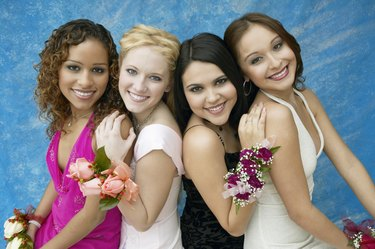 Portrait of Four Girls Wearing Evening Dresses and Corsages