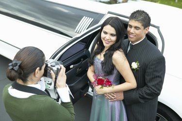 Mother Photographing Couple Departing for Their High School Prom