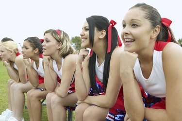 Group of Cheerleaders Sitting in a Line