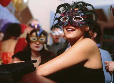 Group of young people at party wearing masks